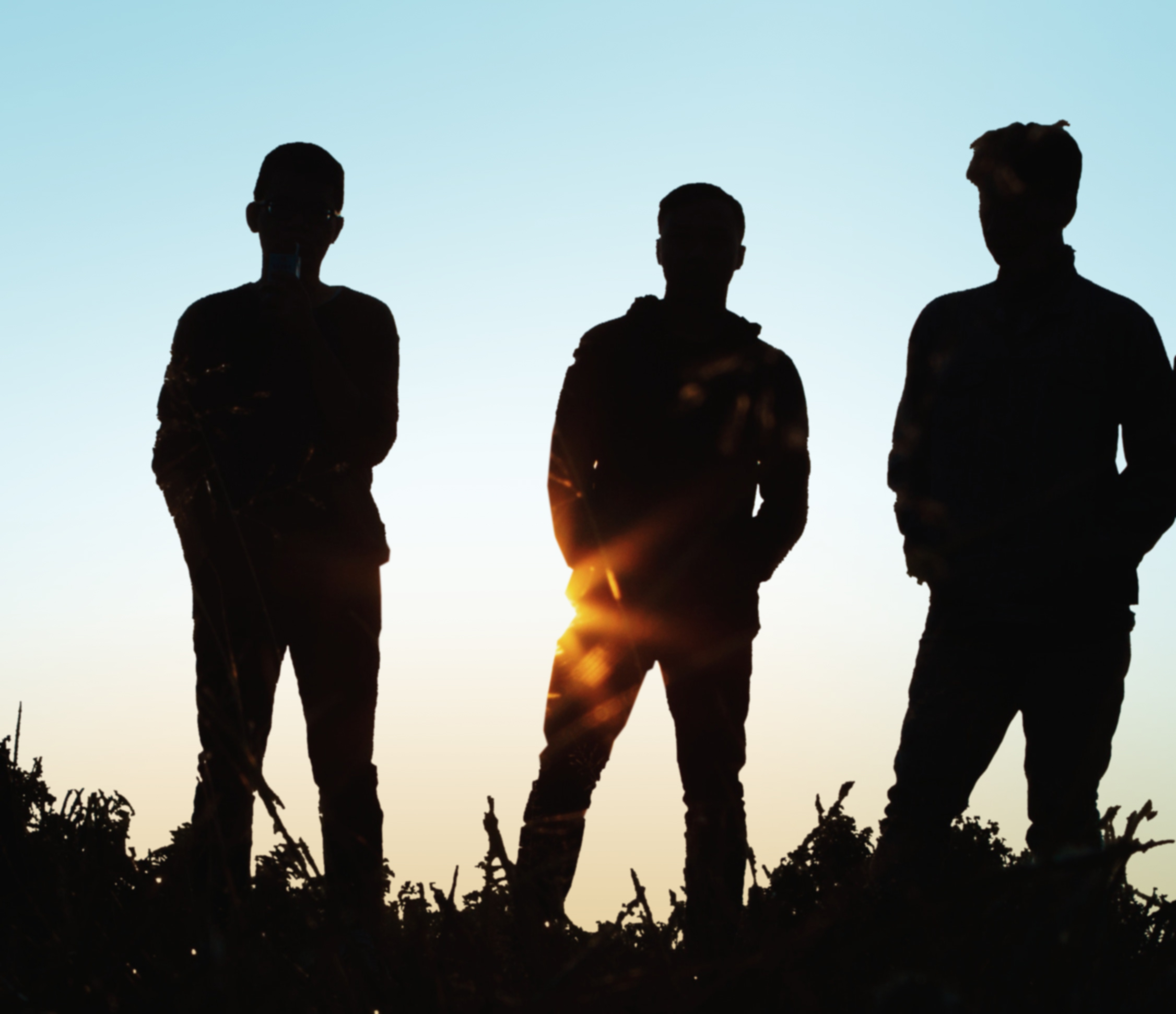 silhouette-group-of-people-standing-on-grass-field-1250346-blue
